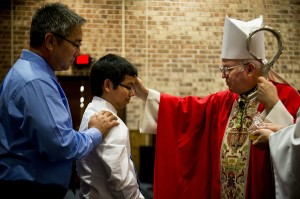 Bishop_visits_Moody,_leads_confirmation_130129-F-PO994-080